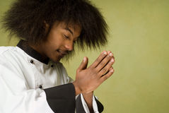 Young Chef Praying Royalty Free Stock Image