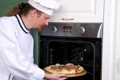 Young chef prepared italian pizza Stock Photos