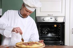Young chef prepared italian pizza Royalty Free Stock Photos