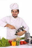 Young chef preparing lunch Stock Photo