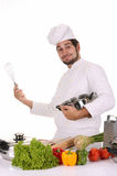 Young chef preparing lunch Stock Images