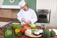 Young chef preparing lunch in kitchen Royalty Free Stock Photo