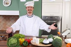 Young chef preparing lunch in kitchen Stock Image