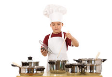 Young chef preparing a meal Stock Photos