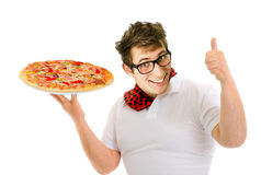Young chef preparing pizza Royalty Free Stock Images