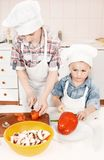 Young chef preparing vegetables in the kitchen Royalty Free Stock Photography