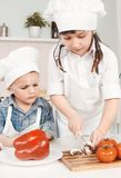 Young chef preparing vegetables in the kitchen Stock Photo