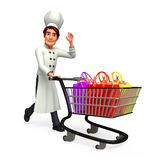 Young Chef with shopping bags and trolley Royalty Free Stock Image