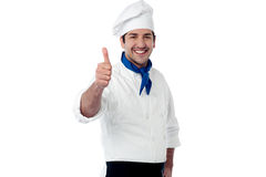 Young chef showing double thumbs up Stock Image