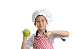 Young chef showing green apple in his hand isolated Stock Photography