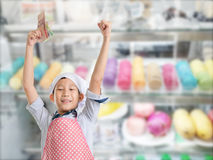 Young chef showing Thai money Stock Photo