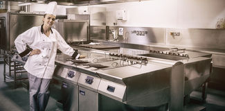 Young chef standing next to work surface. In professional kitchen royalty free stock photos