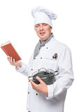 Young chef studying soup recipe portrait Royalty Free Stock Image