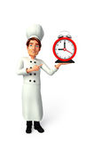 Young chef with table clock Royalty Free Stock Images