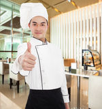 Young chef with thumb up gesture Stock Images