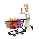 Young chef is with trolley and shopping bags Royalty Free Stock Images