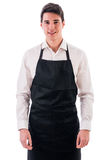 Young chef or waiter wearing black apron isolated. Young chef or waiter posing, wearing black apron and white shirt isolated on white background stock images