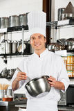 Young Chef With Wire Whisk And Mixing Bowl Royalty Free Stock Images