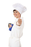 Young chef woman with big cup and thumb up Royalty Free Stock Photos