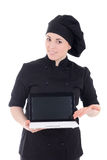 Young chef woman in black uniform showing laptop with copypaste Stock Image