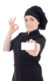 Young chef woman in black uniform showing visiting card isolated Stock Photo