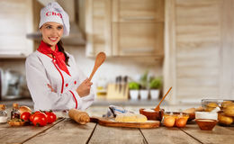 Young chef woman cooker ready for food preparation Royalty Free Stock Photo