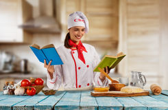 Young chef woman cooker ready for food preparation Royalty Free Stock Photos