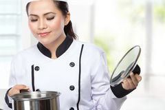 Young Chef woman cooking Royalty Free Stock Photos