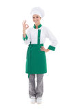 Young chef woman showing ok sign - full length isolated on white Royalty Free Stock Image