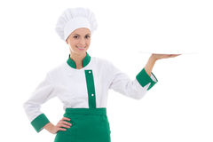 Young chef woman in uniform with empty plate isolated on white Royalty Free Stock Photography
