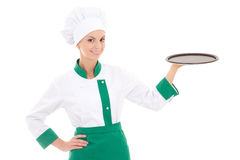 Young chef woman in uniform holding big empty tray isolated on. White background stock image