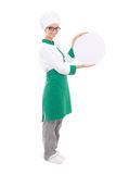 Young chef woman in uniform holding big  tray with copy space - Royalty Free Stock Images