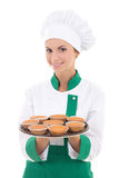 Young chef woman in uniform holding tray with muffins isolated o Stock Images