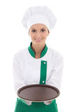 Young chef woman in uniform showing empty plate isolated on whit Royalty Free Stock Photos