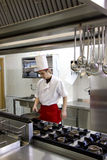 Young chef working Stock Photo