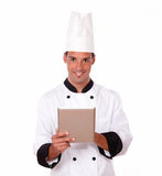 Young chef working with his tablet pc Royalty Free Stock Photo