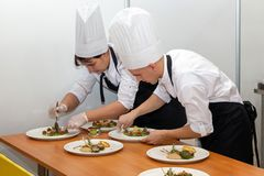Free Young Chefs Prepare Dessert Dishes For The Competition Royalty Free Stock Images - 165643009