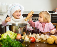 Young chefs prepare meal Royalty Free Stock Photos