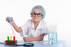 Young Chemist gaining pipetted liquid from a test tube Stock Image