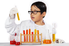 Young chemist holding chemistry. Young asian chemist holding chemistry fluid on a beaker, isolated on white Royalty Free Stock Photo