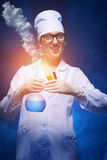 Young chemist makes the experience. Of with the smoke. studio shot royalty free stock photo