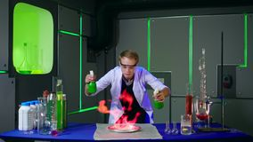 Young chemist making experiments in laboratory stock video