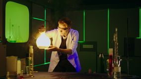Young chemist making experiments in laboratory stock footage