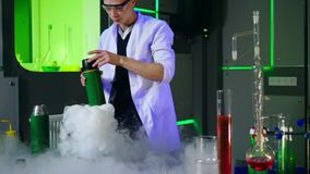 Young chemist making experiments in laboratory stock video footage