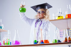 Young chemist posing with variety of reagents Royalty Free Stock Photos