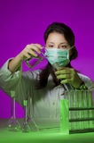 Young chemist research. Young girl in the school chemistry laboratory doing research Royalty Free Stock Photo