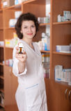 Young chemist showing bottle of pills Royalty Free Stock Images