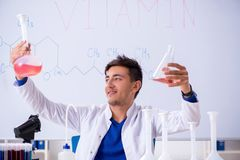The young chemist sitting in the lab royalty free stock images