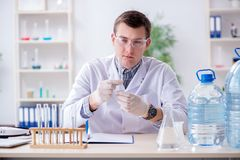 The young chemist student experimenting in lab. Young chemist student experimenting in lab Stock Photo