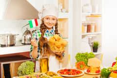 Young chief cook making Italian pasta at kitchen Stock Photography